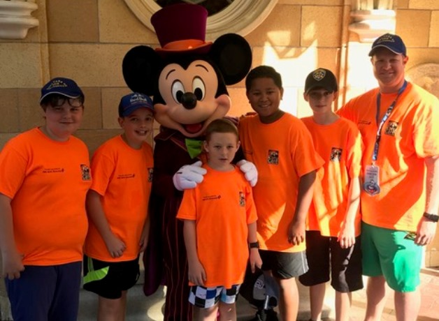 Campbell List with Micky Mouse and some of the kids on the trip.