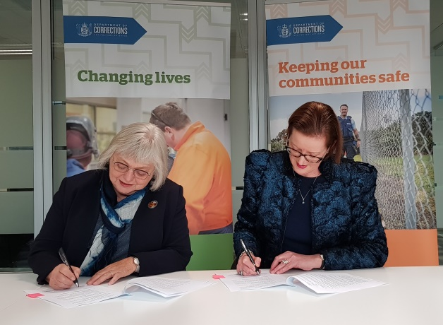 Judge Coral Shaw and Chief Executive Christine Stevenson sign the MOU.