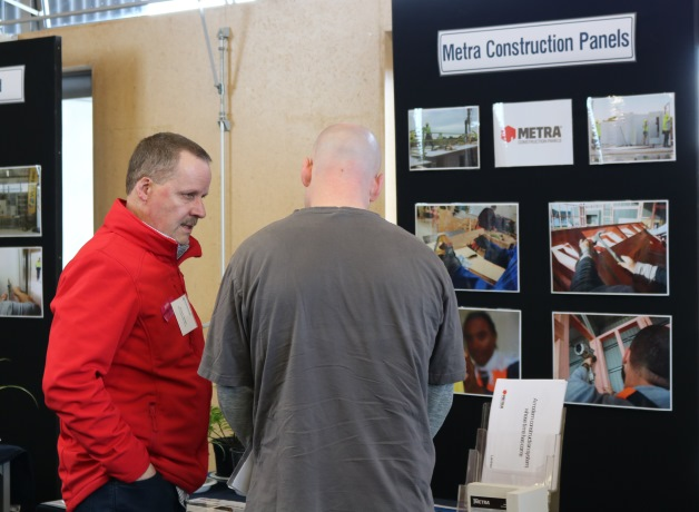 Richard Younger from Metra Construction Panels chats to one of the men about his business